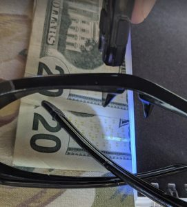 You can test your own glasses for UV protection with a $  20 bill and a UV light.