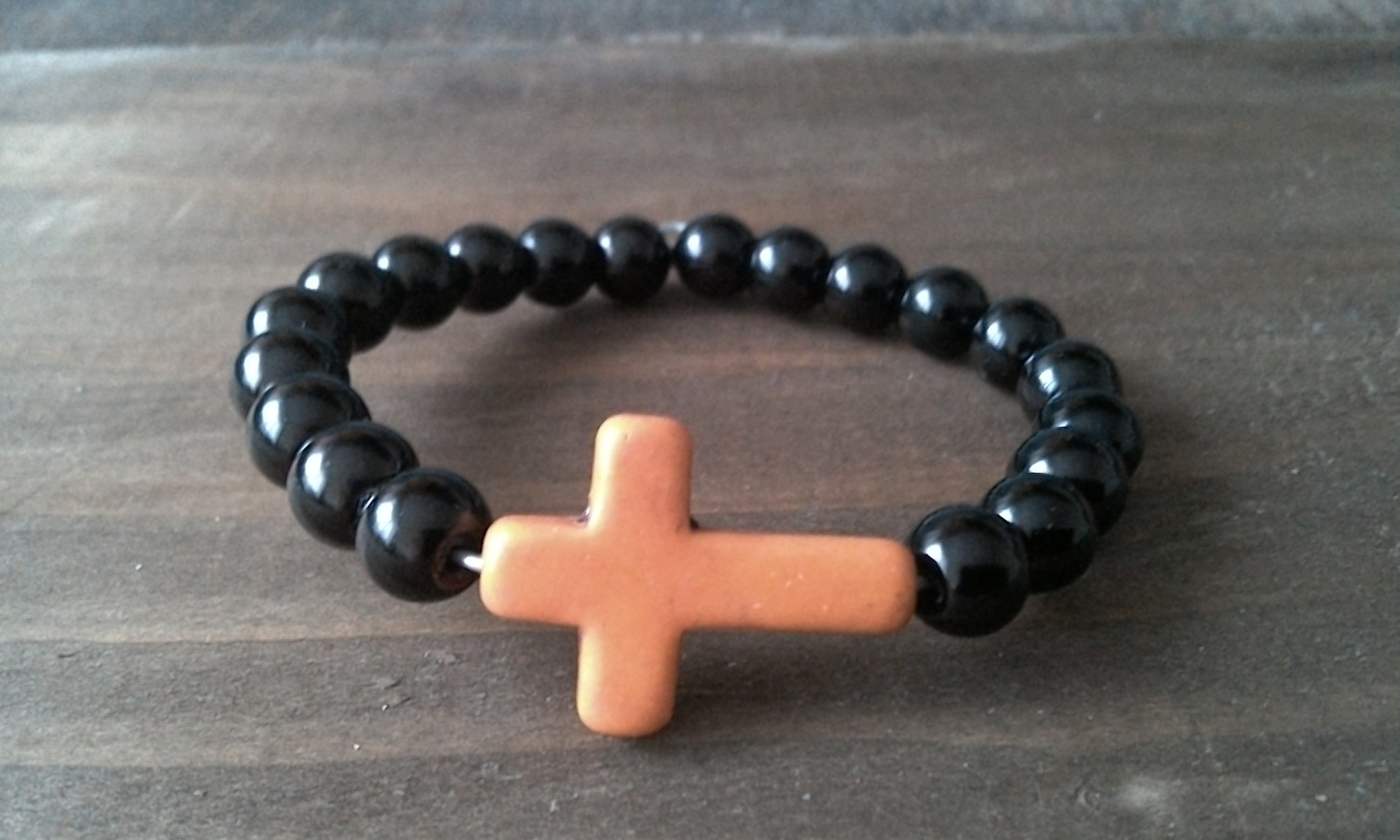 Handmade prayer beads bracelets with orange stone cross