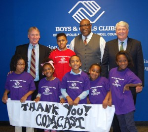 "Chris Comer, Comcast director of government and community affairs, Reginald Broddie, chief professional officer of the Boys & Girls Clubs of Annapolis & Anne Arundel County and Mike Busch, Speaker of House of Delegates, are joined by Boys & Girls Clubs of Annapolis & Anne Arundel County members Christian Jones (in red) and (left to right) Kaliah Ford, Tae' Fisher, Aaron LeBlanc, Madison Carey and Amaya Weston.  Comcast recently presented a $20,000 Comcast Foundation Grant to the Boys & Girls Clubs that will be used to support its ""Club Tech"" digital literacy program. (Courtesy Photo)"