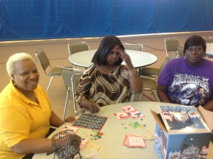 """Refugees"" (L-R) Muriel Hicks, Patricia Lamb and Barbara Prather play bingo in the Pip Moyer shelter."