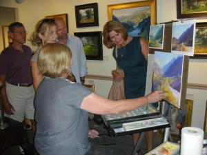 Lisa Mitchell, demonstrating painting a pastel landscape at McBride Gallery in a previous year's Annapolis Art Walk