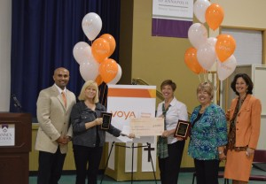 On October 17, representatives from Voya visited St. Anne's School to present an award for the 2015 Unsung Heroes Award competition in front of school faculty, students, and guests. Pictured from left to right are: Nehal Thaker, Regional Vice President, North Atlantic Region, Voya; Judy Fedinick, Middle School Humanities Teacher, St. Anne's School; Lisa Nagel, Head of School, St. Anne's School; June Blaszkiewicz, Volunteer Consultant, St. Anne's School grandparent; and Robin Laird, Investment Adviser Representative, Voya.