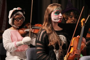 Students of South River High School join the Londontowne Symphony Orchestra in playing Halloween-themed classical music.