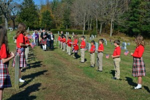 The fourth and fifth grade students in the flag line for the bagpipe procession at Rockbridge Academy's Veterans Day Ceremony