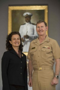 Vice Admiral Walter Carter, Jr., Superintendent of the United States Naval Academy (keynote speaker) and Miriam Stanicic, Community Relations Director of the United States Naval Academy (Drum Major Award Winner) discuss how far the Naval Academy has come as a center of diversity since Wesley A. Brown, became the first African American to graduate from the Academy in 1949.  They are standing in front of a portrait of Brown in the field house named in his honor. The MLK Jr. Banquet will take place on January 16 in Glen Burnie. Photo credit:   Tyler Caswell
