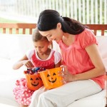 mother-and-daughter-inspecting-halloween-candy-300x300