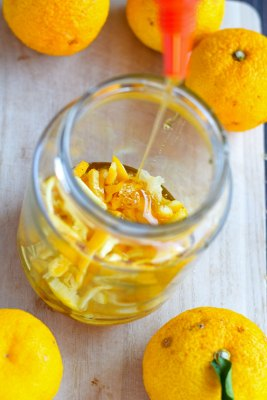 pour honey on sliced yuzu peel