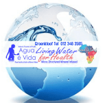 Blue wave curling over label of Agua e Vida which is floating upward in a pool of water with Africa outlined under the water