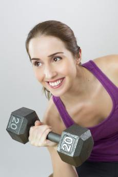 woman lifting weight for her PPO or HMO