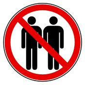 sign with 2 silhouettes standing next to each other with red circle with cross over it.