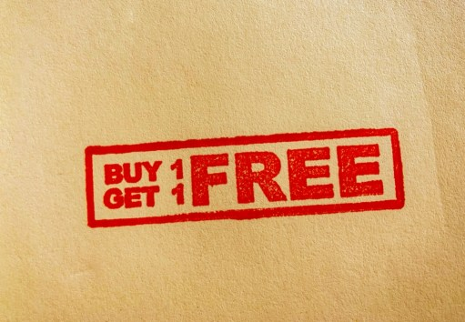 buy one get one free stamped on tan paper.