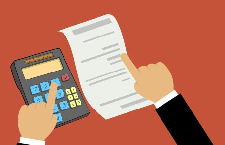 person's hand over a bill and the other over a calculator