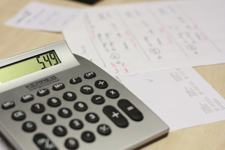 calculator with the numbers 549 on it and paper behind it in the background