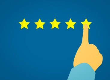 a finger pointing at the 5th star of a rating