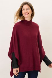 Rib detailing at the neck and hem complete this stylish piece - the perfect loose layer on cold days. Capture Poncho Style Number: 151510