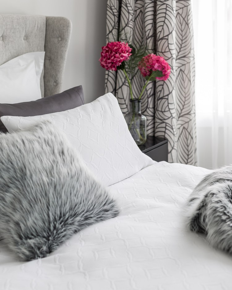 Add the Nile Faux Fur Throw and cozy pillows to add texture and warmth.