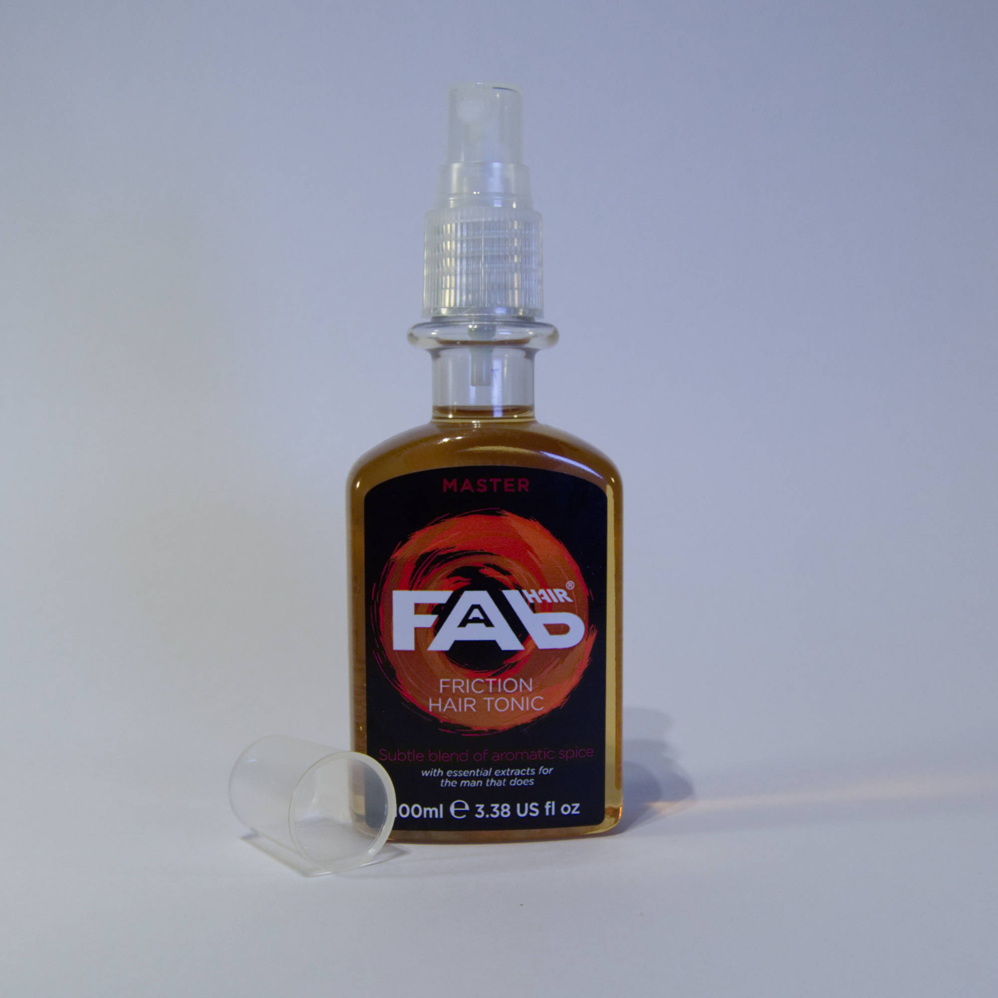 100ml bottle of Master flavoured FAB friction hair tonic with Spray Nozzle