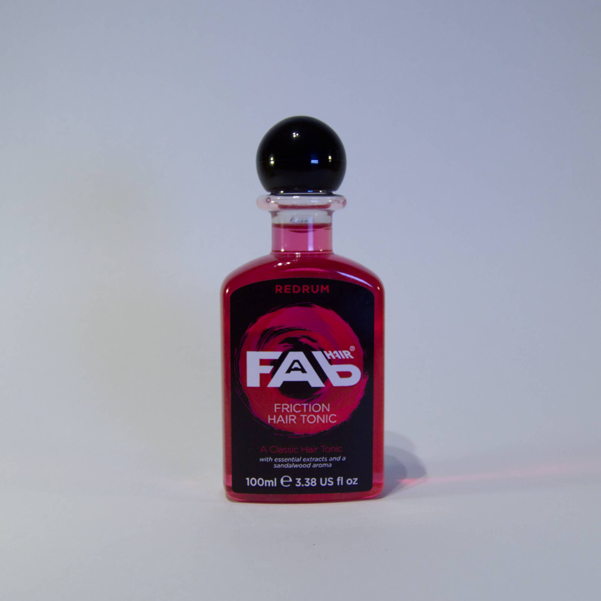 100ml bottle of Redrum flavoured FAB friction hair tonic
