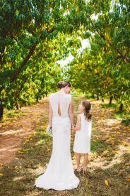 bride and flower girl in white Wedding in The Peach Orchard | Photography : marymargaretsmith.com | https://www.fabmood.com/a-cozy-fall-wedding-in-the-peach-orchard #peach #fallwedding