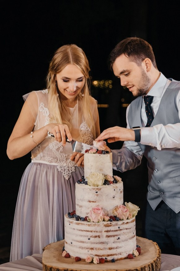 Cutting the cake - Semi naked wedding cake for a rustic boho wedding | fabmood.com #weddingcake #cake #nakedcake #nakedweddingcake