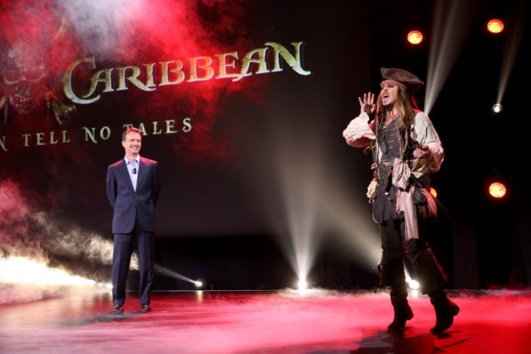 "ANAHEIM, CA - AUGUST 15: President of Walt Disney Studios Motion Picture Production Sean Bailey (L) and actor Johnny Depp, dressed as Captain Jack Sparrow, of PIRATES OF THE CARIBBEAN: DEAD MEN TELL NO TALES took part today in ""Worlds, Galaxies, and Universes: Live Action at The Walt Disney Studios"" presentation at Disney's D23 EXPO 2015 in Anaheim, Calif. (Photo by Jesse Grant/Getty Images for Disney) *** Local Caption *** Johnny Depp; Sean Bailey"