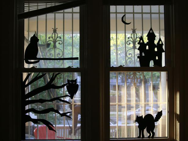 Windows With Spooky Silhouettes On Halloween
