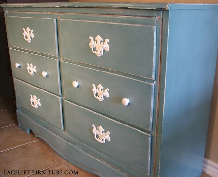 Distressed Sea Blue Dresser with White Glaze & Pulls. Facelift Furniture DIY Blog.