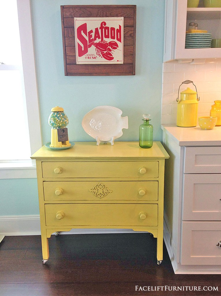 Dresser makeover in distressed yellow with black glaze. From the Beach House collection at Facelift Furniture.