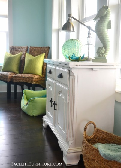 Cabinet makeover in distressed antiqued white with tobacco glaze. From the Beach House collection at Facelift Furniture.