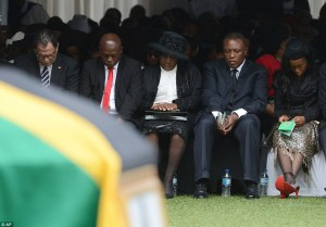 The_wife_of_slain_Senzo_Meyiwa, his father Sam second from left