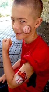 face painting, baseball, flames, Cincinnati Reds