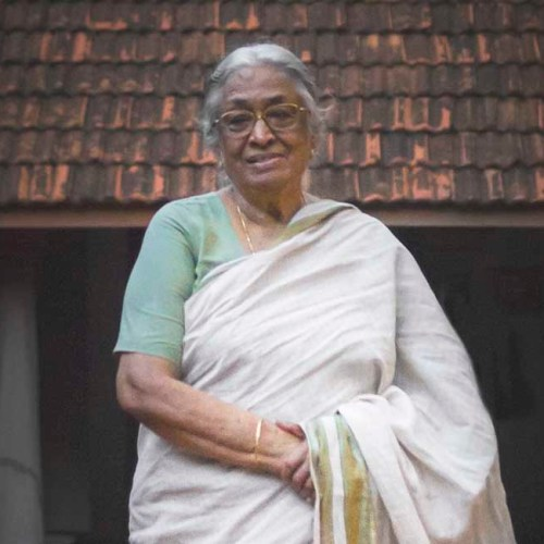 A portrait of Mrs. Meenakshi Meyyappan, proprietor of The Bangala Hotel, in the courtyard of her Karaikudi home.