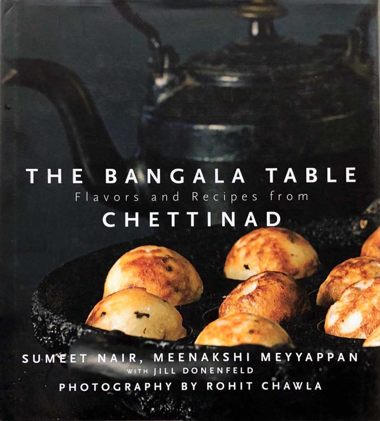 The darkly toned cover of The Bangala Table cookbook.