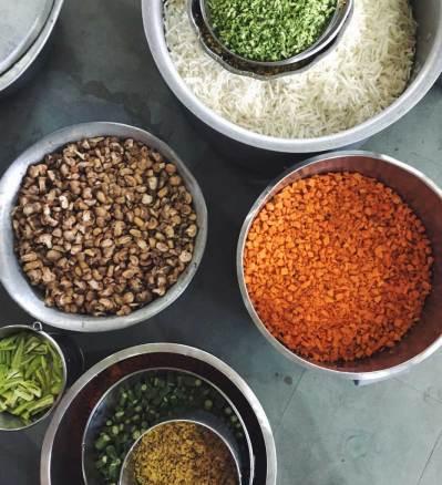 Vegetable preparation at the Akshaya at Isha Yoga Center in Coimbatore, Tamil Nadu, India