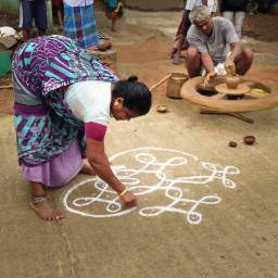 The beginnings of a mandala, a traditional Indian welcome made at the entry to a home