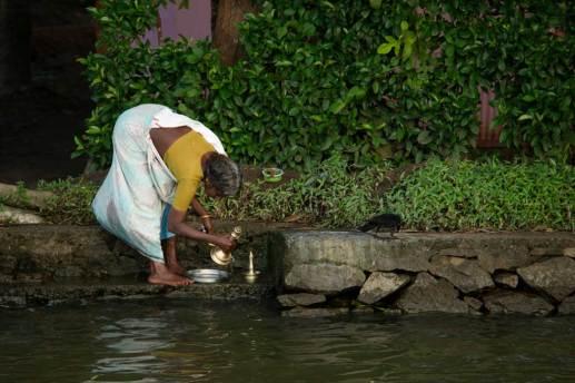 Washing brass wear along the Keralan backwaters.