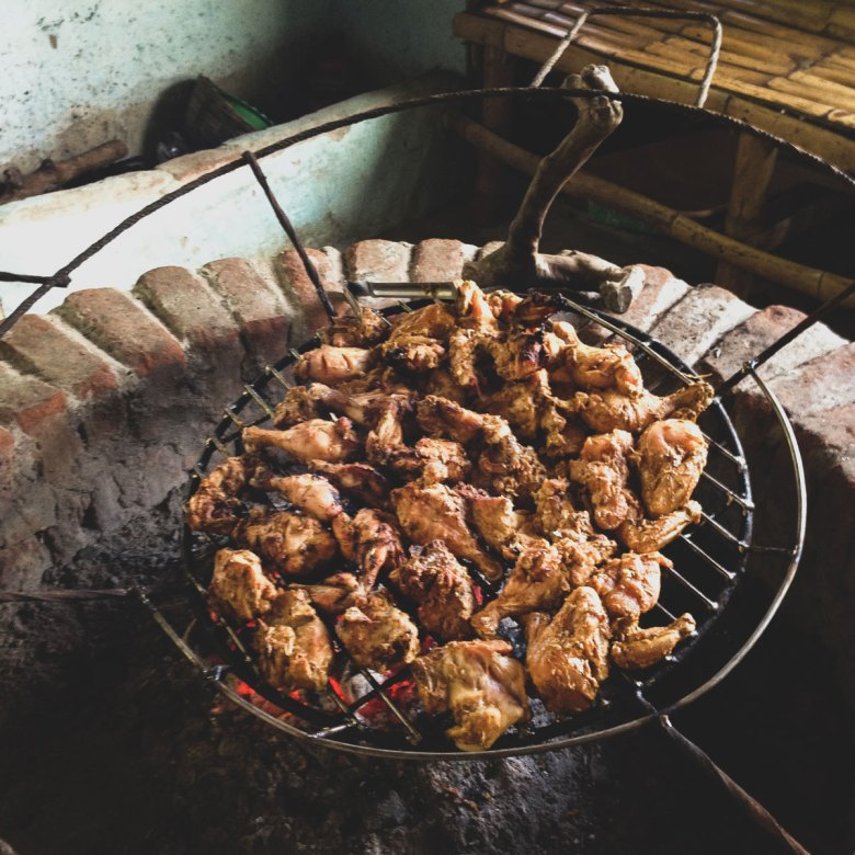 Chicken on the grill at Thekkady Barbeque Cooking School.