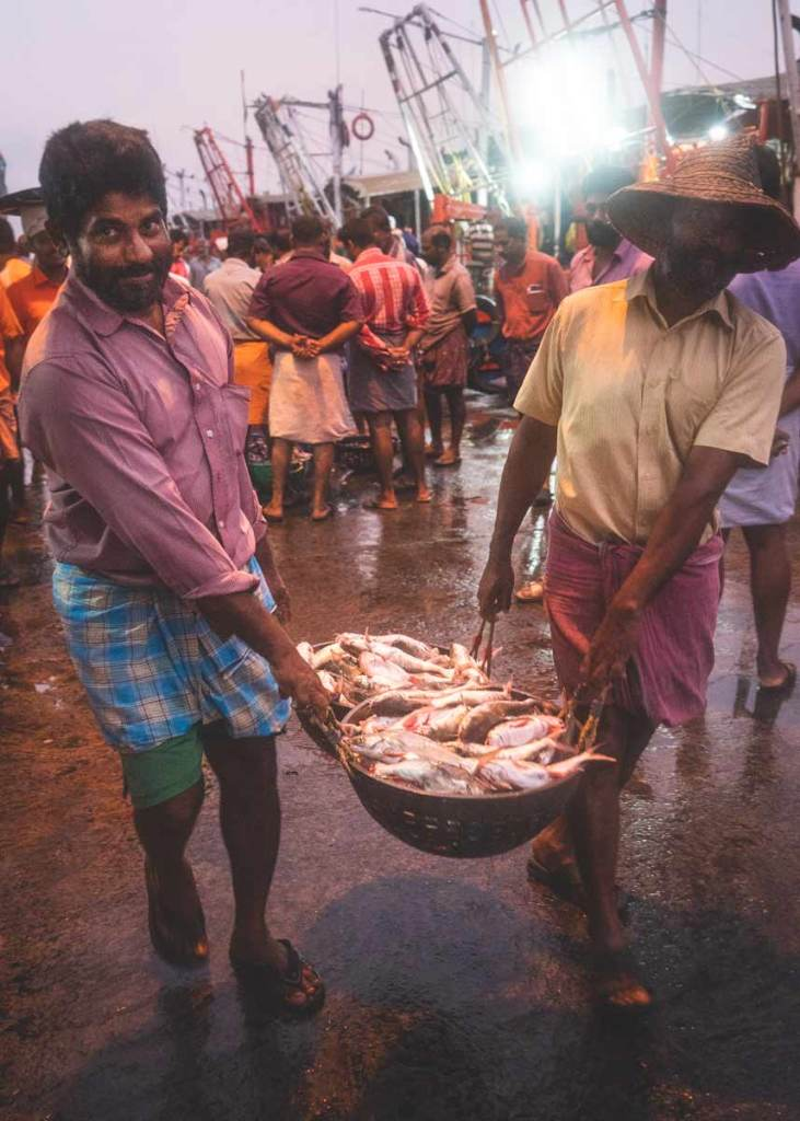 Kozhikode-Fish-Auction-Men-with-Basket-of-Fish