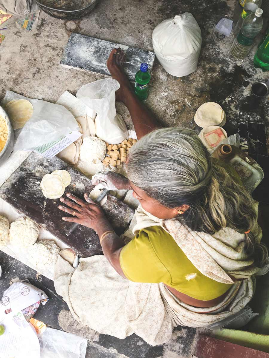 Papadam maker rolling dough