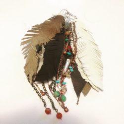 a pile of faerwear earrings