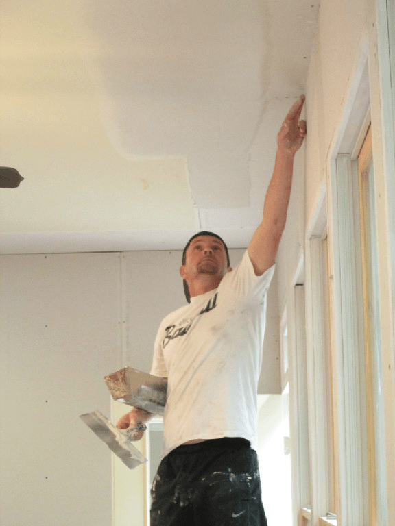 Mike Faircloth covering mesh tape with sheetrock joint compound