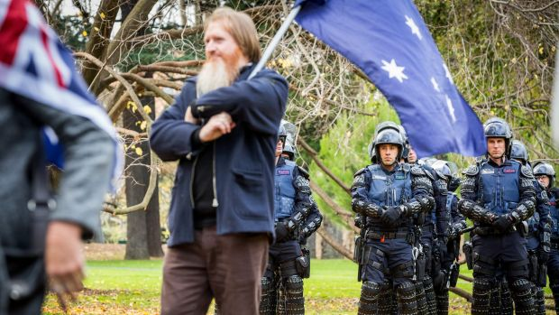 Victorian Special Operations Police members watch over members of the True Blue Crew at the Australian Pride March.