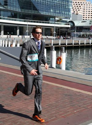 Sydney lawyer Matthew Whitaker, 25, ran the 42-kilometre Sydney Running Festival dressed in a suit – and broke a ...
