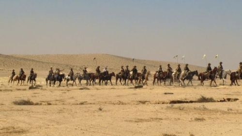 Long line of horse riders.