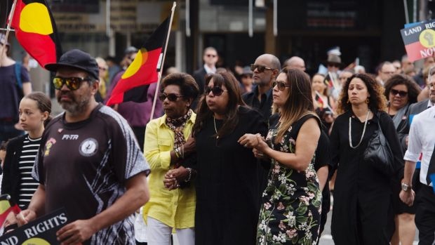 Mourners march through Redfern ahead of the state funeral for activist Sol Bellear.