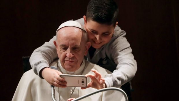 Even Pope Francis, it seems, can fall for the allure of a selfie.