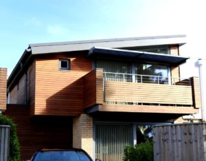 a wooden house with a balcony