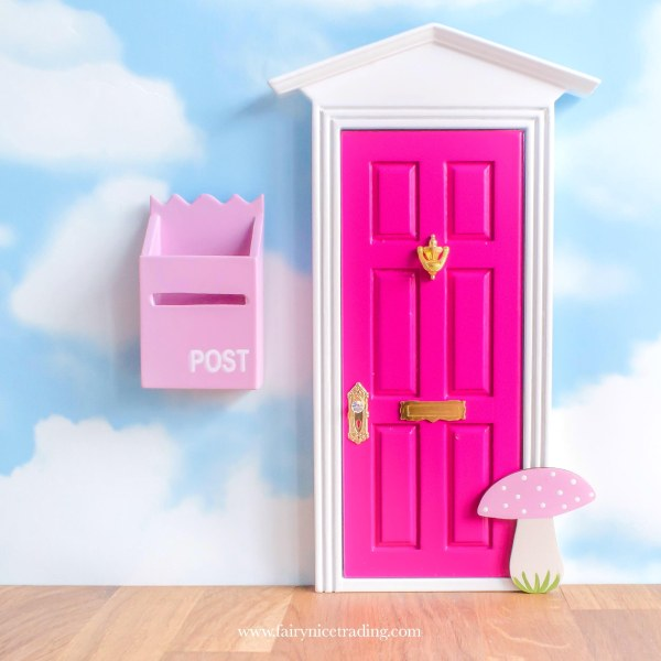 bright pink fairy door with pink toadstool