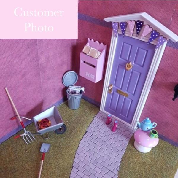 customer photo purple fairy door with bunting