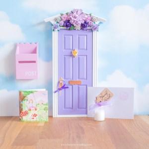 purple fairy door with flower wall uk